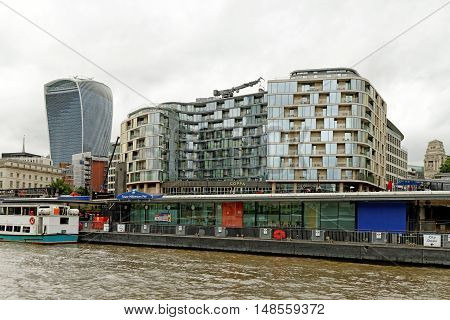 LONDON, ENGLAND - JULY 8, 2016: Cheval Three Quays - a multi-award winning residence on the river Thames next to Tower of London.