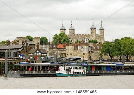 LONDON, ENGLAND - JULY 8, 2016: Tower of London - a historic castle located on the north bank of the River Thames in central London. It is one of the most popular tourist attractions in the country.