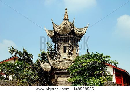 Luo Dai China - October 13 2007: The ancient Word Stone tower with flying eave roofs and carved dragons
