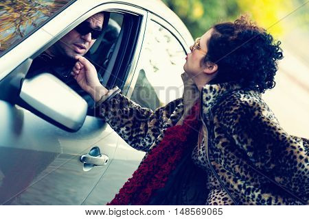 Roadside prostitute teasing car driver.. horizontal image, toned image,
