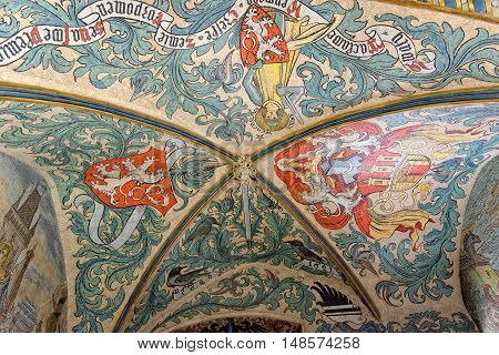 PRAGUE CZECH REPUBLIC - JULY 03 2014: Vibrant mosaic frescoes decorate the vaulted interior at the first floor of the Old Town Hall (Staromestska Radnice) in Prague Czech Republic.