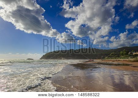 Summertime.Gargano coast: Portonuovo beach,Vieste-(Apulia) ITALY-It is a succession of fine sand dunes,crossed by many little kars streams,that cool the visitors in the hot summer time.