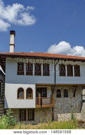 Giginski monastery, Bulgaria - June 25, 2016: Part of exterior monastic house in restored Montenegrin or Giginski monastery  St. St. Cosmas and Damian, mountain Kitka, Breznik, Pernik region, Bulgaria.  Visit in the place circa June 2016.