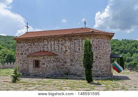 Giginski monastery, Bulgaria - June 25, 2016:  View of inner  yard with old medieval church  in restored Montenegrin or Giginski monastery  St. St. Cosmas and Damian, mountain  Kitka, Breznik, Pernik region, Bulgaria. Visit in the place circa June 2016.