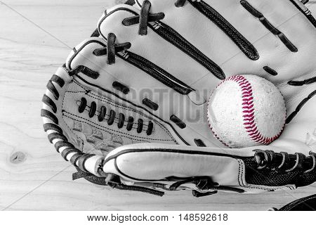 baseball glove and baseball in black and white