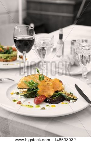 Salmon and vegitable  with glass of red wine