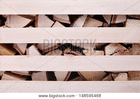 firewood in the box storage of solid fuel close-up