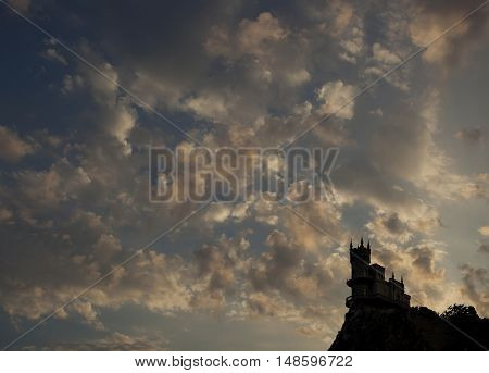 The old palace on a high mountain against the sky.