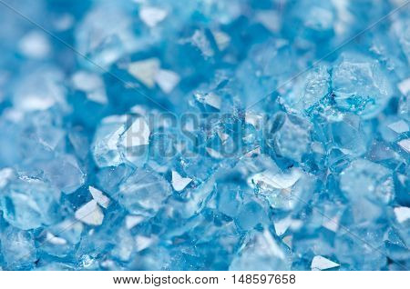 Blue crystals Agate mineral its blurred natural background. Macro. Focus on the central. Very shallow depth of field