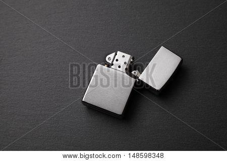 gasoline lighter metal lighter on a dark background