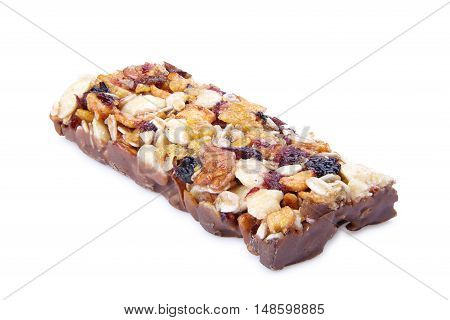 Sweet cereal bar with different berries and fruits. Diet sweets healthy food isolated on white