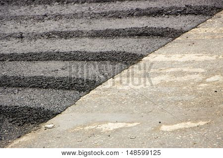 Freshly Laid Black Tar Asphalt Pavement Close-up