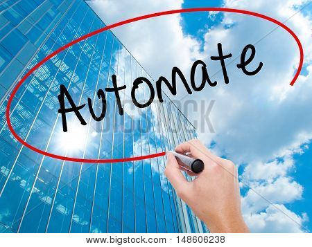Man Hand Writing Automate With Black Marker On Visual Screen