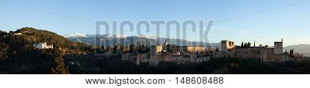 GRANADA, SPAIN - JANUARY 12, 2016: Panorama of the Alhambra Palace in Granada, Andalusia, Spain, pictured from the Mirador de San Nicolas in El Albayzin district.