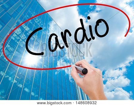Man Hand Writing Cardio With Black Marker On Visual Screen