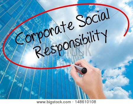 Man Hand Writing Corporate Social Responsibility With Black Marker On Visual Screen.