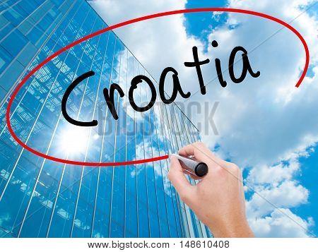 Man Hand Writing Croatia  With Black Marker On Visual Screen