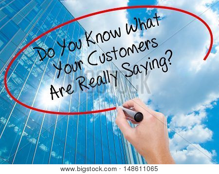 Man Hand Writing Do You Know What Your Customers Are Really Saying? With Black Marker On Visual Scre