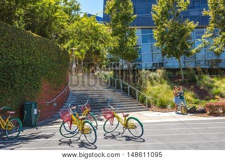 Mountain View, CA, USA - August 15, 2016: bikes used by Google employees to move around the Google headquarters. Google is a multinational corporation specializing in Internet services and products.