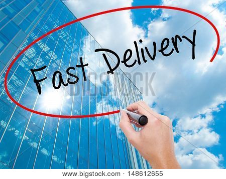 Man Hand Writing  Fast Delivery With Black Marker On Visual Screen