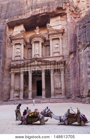 PETRA JORDAN - OCTOBER 28 2014: The treasury - Petra's most elaborate ruin is also called Al Khazna hewn into the sandstone cliff.