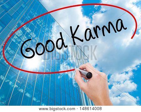 Man Hand Writing  Good Karma With Black Marker On Visual Screen