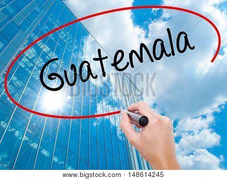 Man Hand Writing Guatemala  With Black Marker On Visual Screen