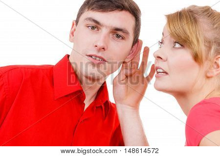 Woman telling man some secrets couple talking gossiping. Excited emotional girl whispering to boyfriend ear