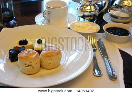 Classic british afternoon tea with scones and cakes