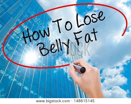 Man Hand Writing How To Lose Belly Fat With Black Marker On Visual Screen