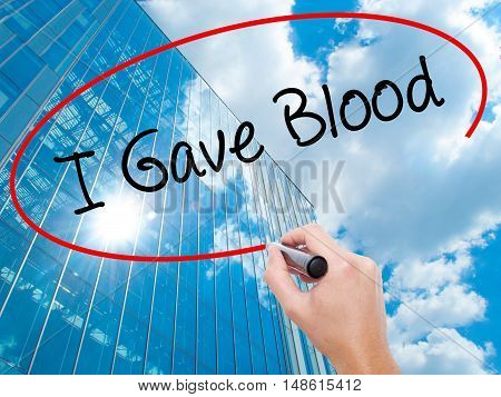 Man Hand Writing I Gave Blood With Black Marker On Visual Screen