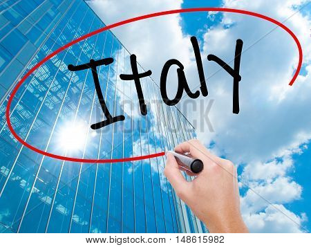 Man Hand Writing Italy With Black Marker On Visual Screen.