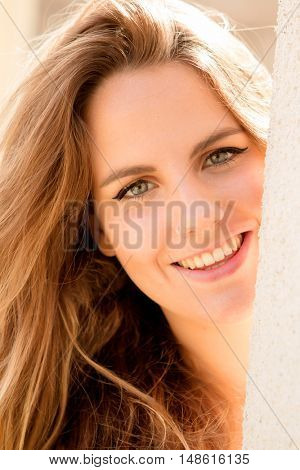 Beautiful woman with blue eyes on a sunny day outside