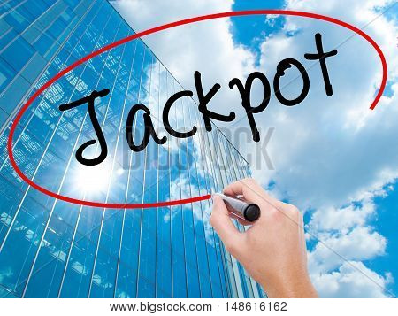 Man Hand Writing Jackpot With Black Marker On Visual Screen