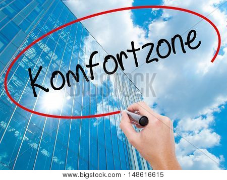 Man Hand Writing Komfortzone  (comfort Zone In German)  With Black Marker On Visual Screen