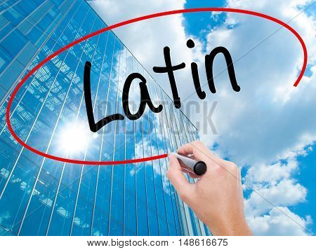 Man Hand Writing Latin With Black Marker On Visual Screen.