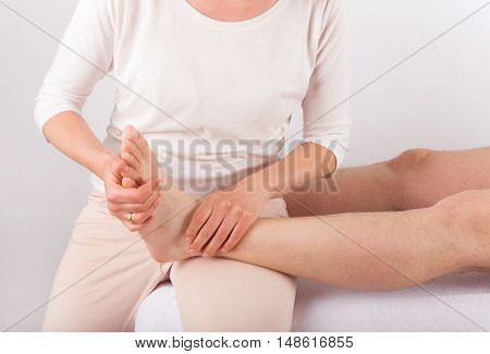 Bowen therapy - Foot massage of a man