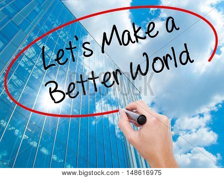 Man Hand Writing Let's Make A Better World With Black Marker On Visual Screen