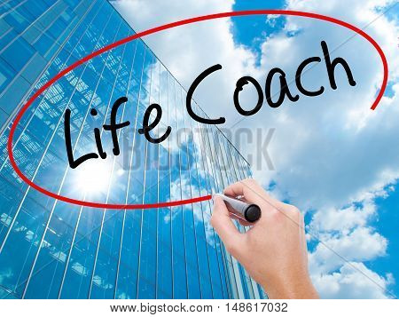 Man Hand Writing Life Coach With Black Marker On Visual Screen