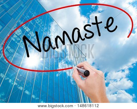 Man Hand Writing Namaste With Black Marker On Visual Screen