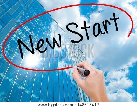 Man Hand Writing New Start With Black Marker On Visual Screen