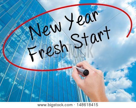 Man Hand Writing New Year Fresh Start With Black Marker On Visual Screen