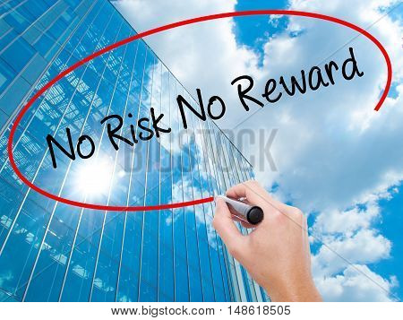 Man Hand Writing No Risk No Reward With Black Marker On Visual Screen