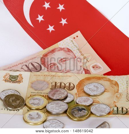 Singaporean flag with dollar notes and coins.