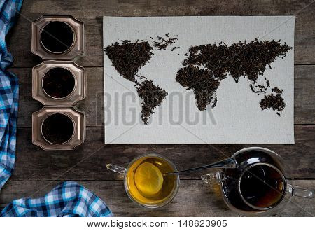 map of the world, lined with tea leaves on old paper. Eurasia, America, Australia, Africa.