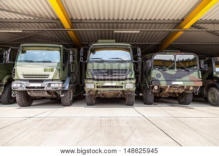 BURG / GERMANY - JUNE 25 : german military trucks stands under military roof on open day in barrack burg / germany at june 25 2016.