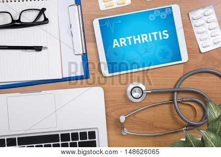 ARTHRITIS Professional doctor use computer and medical equipment all around desktop top view poster