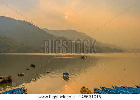 Sunset at Phewa Lake, a famous lake in Phokara, Nepal.