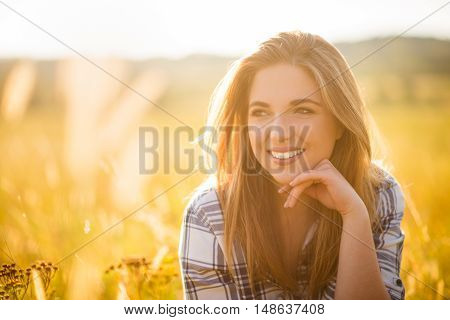 Sunny portrait of teenager outdoor in summer nature