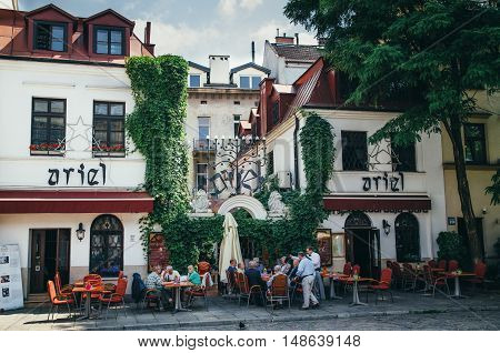 KRAKOW POLAND - JUNE 26 2015: People in the open Ariel Jewish restraurant in Kazimierz